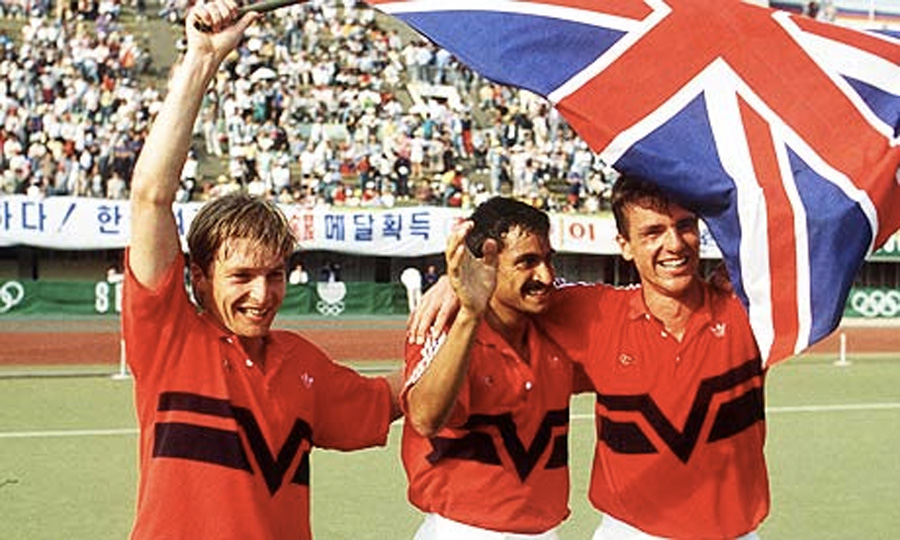 Great Britain's Richard Leman, left, Imran Sherwani, centre and Martyn Grimley celebrate their gold medal win over Australia at the 1988 Seoul Olympics. Photograph: BTS