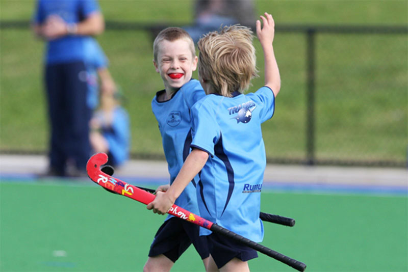 How important is to promote social unity and bonding skills in young hockey teams?