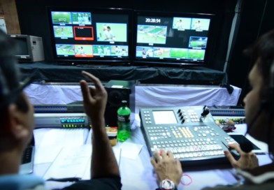 What happens at the production booth during international hockey tournaments?