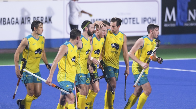 Australia's Matt Dawson, center, celebrates with his teammates after he scored the team's first goal against Great Britain during Sultan Azlan Shah Cup men's field hockey tournament in Ipoh, Malaysia on Wednesday, May 3, 2017. (AP Photo/Adrian Hoe)