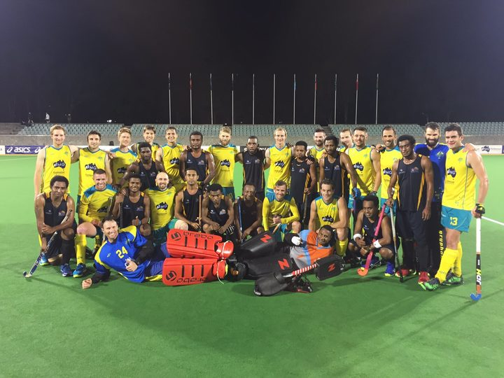 Papua New Guinea players and Kookaburras posing after their match.