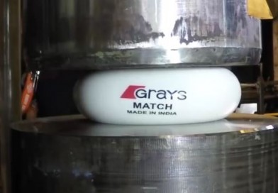 A Grays Match ball against a hydraulic press and other balls…